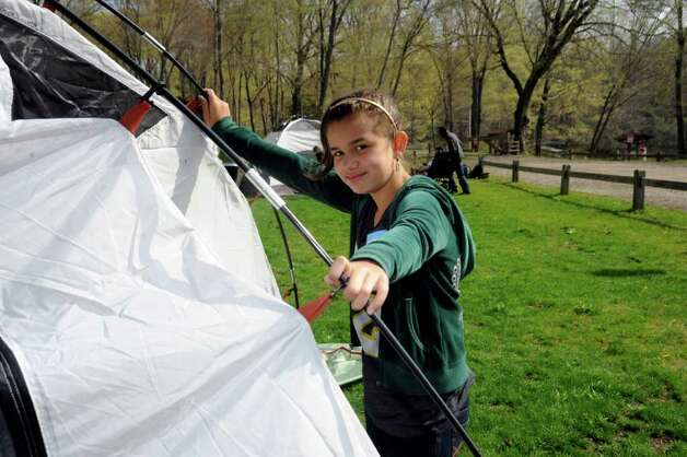"Mariana Sabogal from North Street School puts up a tent as Greenwich Public Schools fifth-graders participate in ""Orienteering Adventure Days"" at Seton Scout Reservation on Tuesday, April 26, 2011 to meet students who will attend their middle schools next year. Photo: Helen Neafsey / Greenwich Time"