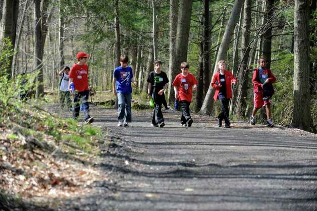 "Boys walk though the woods at the Seton Scout Reservation  as Greenwich Public Schools fifth-graders participated in the ""Orienteering Adventure Days"" at the reservation on Tuesday, April 26, 2011. Photo: Helen Neafsey / Greenwich Time"