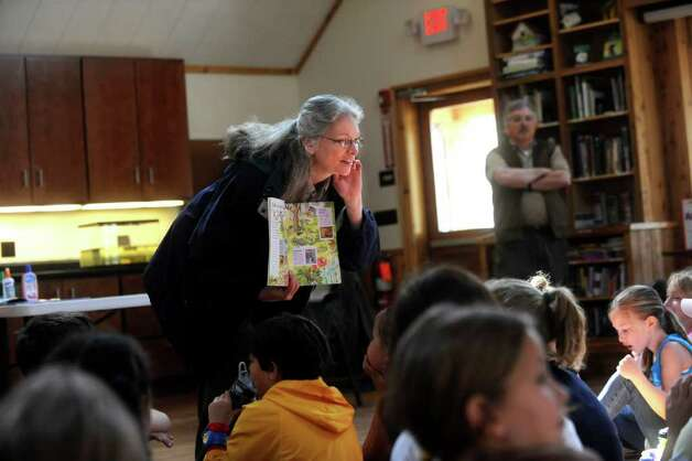 "Camille Broderick, a volunteer for the Boy Scout Council, teaches the children to explore, observe and enjoy nature as the Greenwich Public School fifth-graders participate in ""Orienteering Adventure Days"" at Seton Scout Reservation on Tuesday, April 26, 2011 to meet students who will attend their middle schools next year. Photo: Helen Neafsey / Greenwich Time"