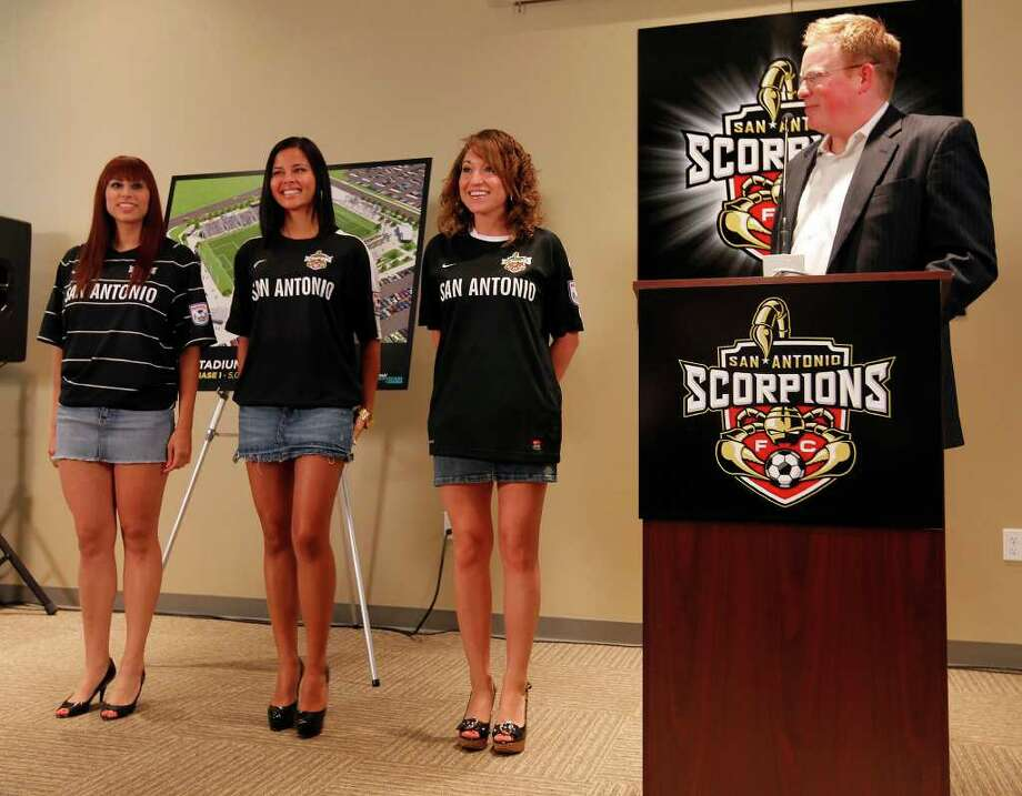 Michael Hitchcock, president of the San Antonio Scorpions, introduces three models wearing proposed uniforms for the soccer team at a press conference on the upcoming season and their plans for a stadium at Morgan's Wonderland on Tuesday, April 26, 2011. The uniform will be chosen by fans' votes. Photo: Kin Man Hui/kmhui@express-news.net / San Antonio Express-News