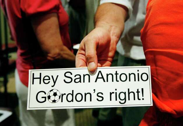 Stickers are handed out by a soccer fan after Gordon Hartman's press conference about the upcoming San Antonio Scorpions season and their plans for a stadium near Morgan's Wonderland on Tuesday, April 26, 2011. Photo: Kin Man Hui/kmhui@express-news.net / San Antonio Express-News
