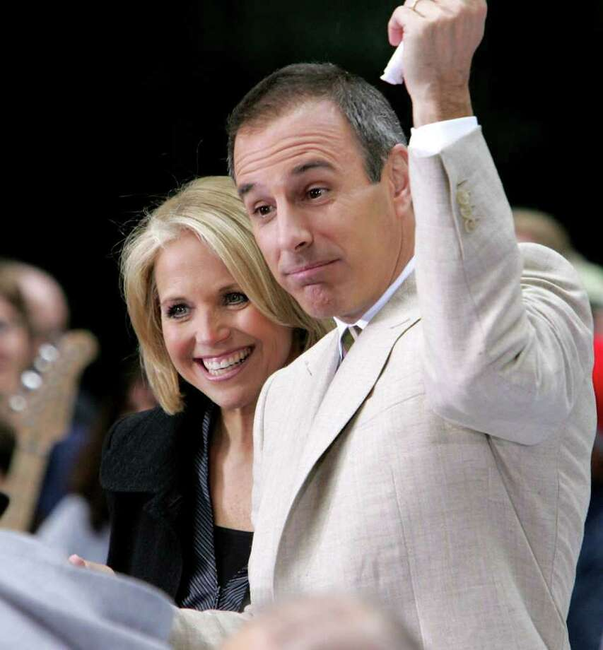 "NEW YORK - JUNE 3:  ""Today"" Show hosts Katie Couric and Matt Lauer wrap up the show after the Black Eyed Peas performed onstage during the Toyota Concert Series on the ""Today"" Show June 3, 2005 in New York City. Photo: Paul Hawthorne, Getty Images / 2005 Getty Images"