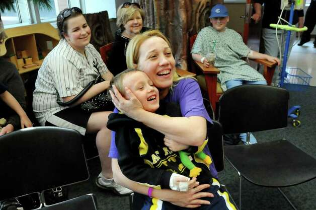 "Patient Bert Heath, 5, center, and his mother Heidi of Cobleskill laugh at the antics of the Ringling Brothers and Barnum and Bailey Circus clowns as they entertain young patients and their families on Tuesday, April 26, 2011, at Albany Medical Center in Albany, N.Y. The ""Greatest Show on Earth"" will be at the Times Union Center from May 5 to 8. (Cindy Schultz / Times Union) Photo: Cindy Schultz"