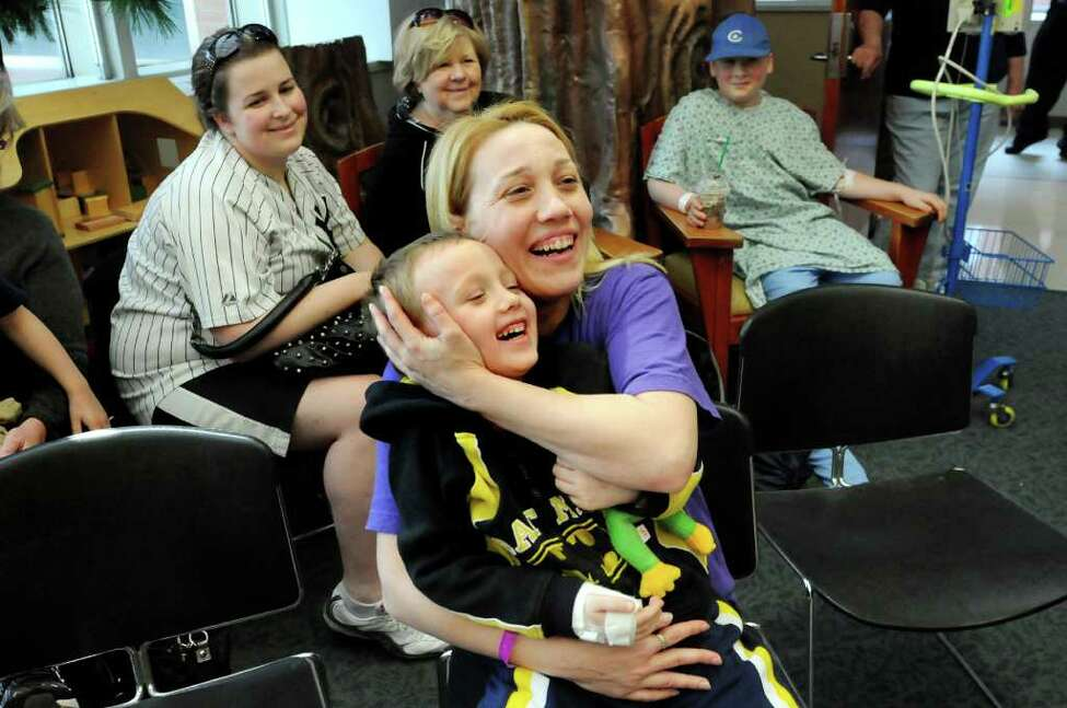 Patient Bert Heath, 5, center, and his mother Heidi of Cobleskill laugh at the antics of the Ringling Brothers and Barnum and Bailey Circus clowns as they entertain young patients and their families on Tuesday, April 26, 2011, at Albany Medical Center in Albany, N.Y. The