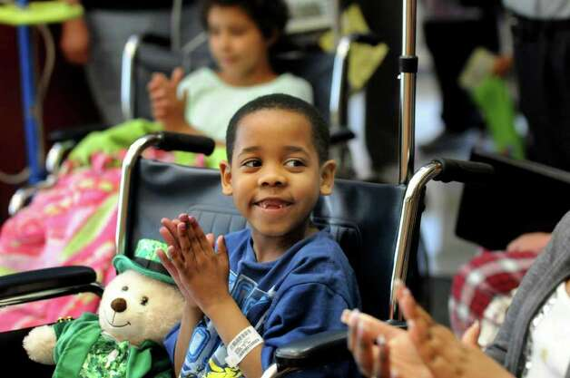 "Patient Donavan Williams, 6, of South Fallsburg, center, applauds the Ringling Brothers and Barnum and Bailey Circus clowns as they entertain young patients and their families on Tuesday, April 26, 2011, at Albany Medical Center in Albany, N.Y. The ""Greatest Show on Earth"" will be at the Times Union Center from May 5 to 8. (Cindy Schultz / Times Union) Photo: Cindy Schultz"