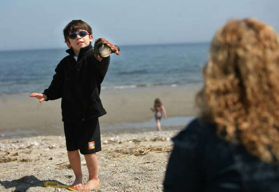 Tyler Fefe, 5 of Fairfield, plays a game of catch with his mother Nalan Fefe at Penfield Beach in Fairfield on Tuesday, April 26, 2011. Tyler said the baseball was one of his presents from the Easter Bunny. Photo: Brian A. Pounds / Connecticut Post