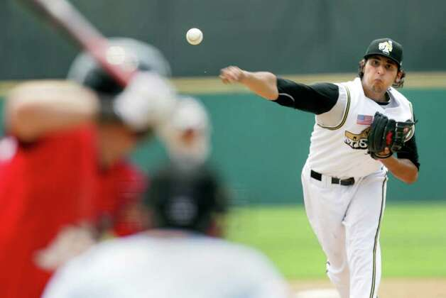 San Antonio Missions  pitcher Jorge Reyes fires a pitch to Frisco RoughRiders Davis Stoneburner in the 5th inning at Wolff Stadium, Tuesday, April 26, 2011. The Missions won 6-5, after a controversial call in the final inning.  Photo Bob Owen/rowen@express-news.net Photo: Bob Owen, San Antonio Express-News / rowen@express-news.net