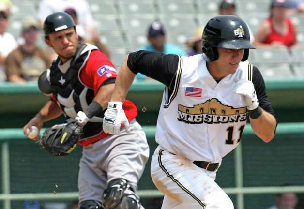 Sports daily - San Antonio Missions Blake Tekotte runs to first after a pass ball but Frisco RoughRiders catcher Elio Sarmiento threw him out, at Wolff Stadium, Tuesday, April 26, 2011. The Missions won 6-5 after a controversial call in the final inning.  Photo Bob Owen/rowen@express-news.net Photo: Bob Owen, San Antonio Express-News / rowen@express-news.net