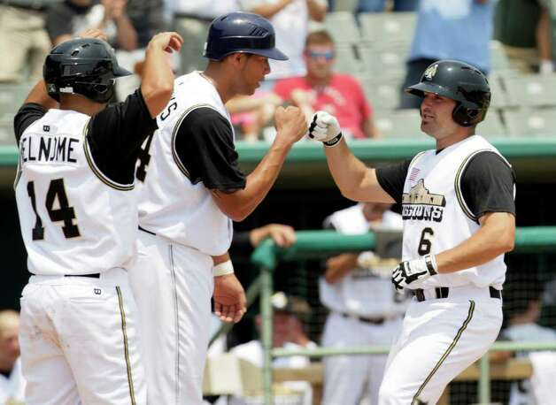 San Antonio Missions Cody Decker, right, is greeted after his three run homer driving in Vince Belnome, right, and Kyle Blanks, center, against the Frisco RoughRiders at Wolff Stadium, Tuesday, April 26, 2011. The Missions won the game 6-5 after a controversial call in the last inning.  Photo Bob Owen/rowen@express-news.net Photo: Bob Owen, San Antonio Express-News / rowen@express-news.net