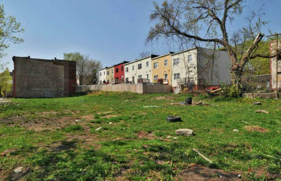 Vacant lots on Alexander St. in Albany Tuesday afternoon April 26, 2011. The site has been chosen by Habitat for Humanity for 10 ne row houses.   (John Carl D'Annibale / Times Union) Photo: John Carl D'Annibale / 00012891A