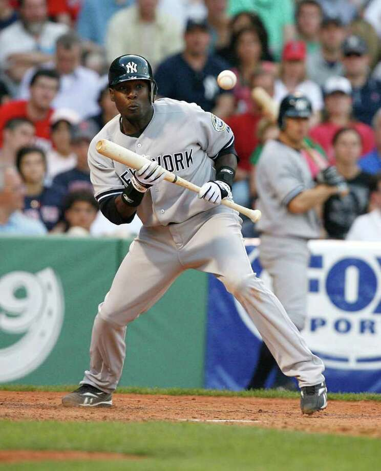 BOSTON - APRIL 25: Angel Berroa #14 of the New York Yankees scores against the Boston Red Sox at Fenway Park on April 25, 2009 in Boston, Massachusetts. (Photo by Jim Rogash/Getty Images) Photo: Jim Rogash, Getty Images / 2009 Getty Images