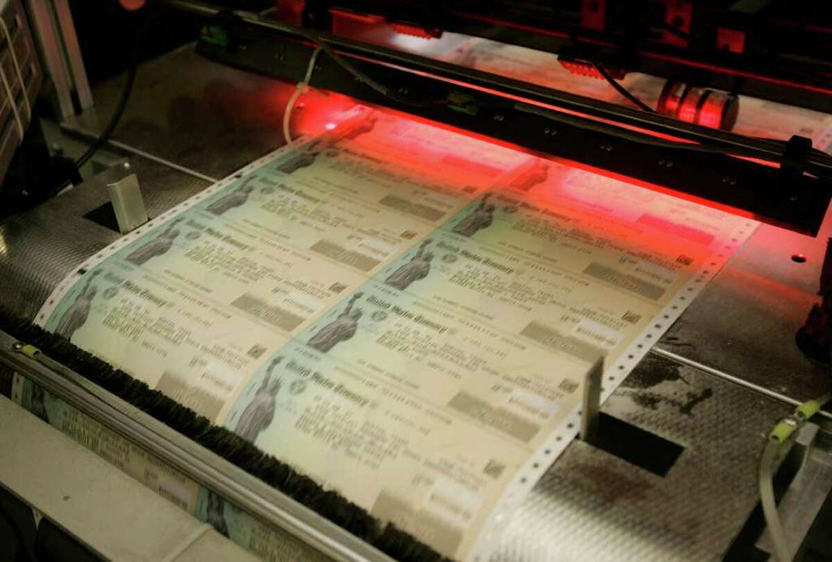 In this file photo, physical checks from U.S. Treasury Department are printed.