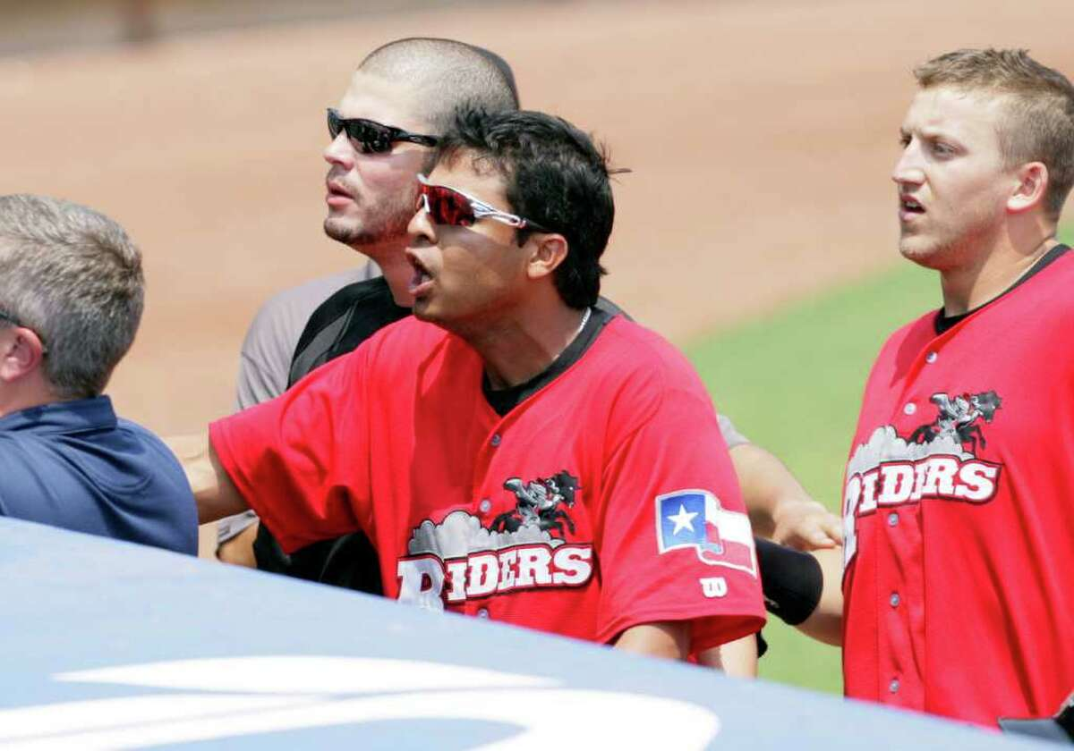 Members of the Frisco RoughRiders react to San Antonio Missions fans as they are heckled after loosing to the Missions 6-5 in a controversial call, at Wolff Stadium, Tuesday, April 26, 2011. Photo Bob Owen/rowen@express-news.net