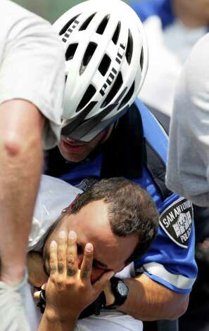 A San Antonio police officer subdues a San Antonio Missions fan after he was involved in an incident involving members of the Frisco RoughRiders at Wolff Stadium, Tuesday, April 26, 2011. The Missions won the game 6-5 after a controversial call at the end of the game.  Photo Bob Owen/rowen@express-news.net Photo: Bob Owen, Bob Owen/Express-News / rowen@express-news.net