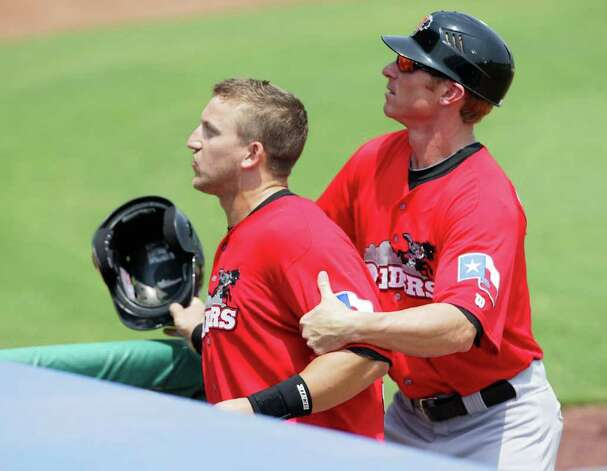 Frisco RoughRiders Hitting Coach Brant Brown, right, restrains his designated hitter Michael Bianucci, after he and other Frisco players got involved in a scuffle with Missions fans after a controversial Missions win 6-5, at Wolff Stadium, Tuesday, April 26, 2011. Photo Bob Owen/rowen@express-news.net Photo: Bob Owen, Bob Owen/Express-News / rowen@express-news.net
