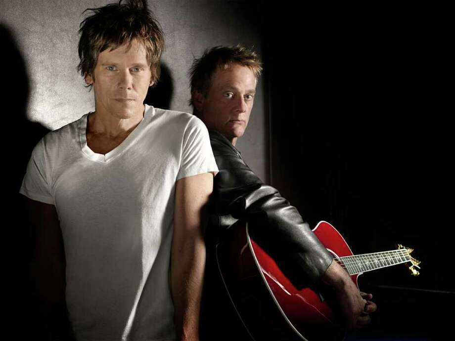 Kevin Bacon and his older brother, Michael Bacon, perform with their band, The Bacon Brothers, at the Ridgefield Playhouse on April 29. Photo: Contributed Photo / The News-Times Contributed