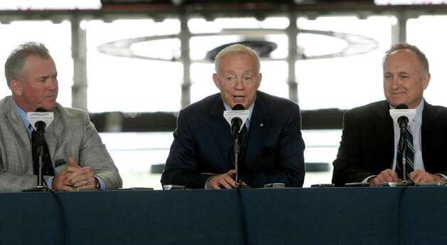 Dallas Cowboys owner Jerry Jones (center), Stephen Jones (left), and director of pro scouting Tom Ciskowski begin a predraft news conference at Cowboys Stadium on Tuesday, April 26, 2011, in Arlington. Photo: L.M. Otero/Associated Press / AP