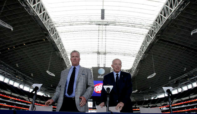Dallas Cowboys owner Jerry Jones (right) and Stephen Jones arrive for a predraft news conference at Cowboys Stadium on Tuesday, April 26, 2011, in Arlington. Photo: L.M. Otero/Associated Press / AP
