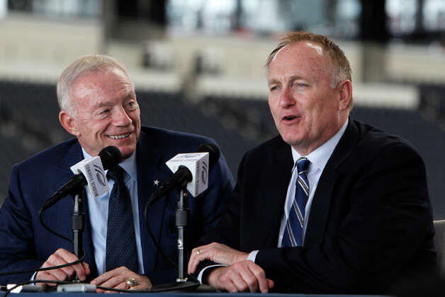 Dallas Cowboys owner Jerry Jones (left) looks on as director of pro scouting Tom Ciskowski speaks during a predraft news conference at Cowboys Stadium on Tuesday, April 26, 2011, in Arlington. Photo: L.M. Otero/Associated Press / AP