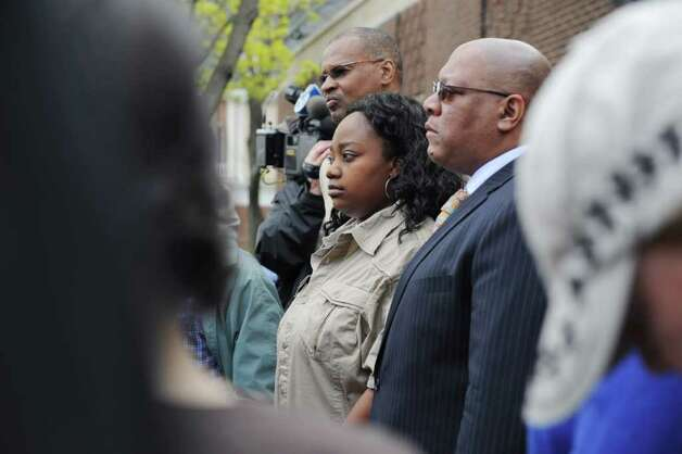 Tanya McDowell looks on during a press conference before her arraignment at Norwalk Superior Court on larceny charges in Norwalk,  Conn. on Wednesday April 27, 2011. She stands with Jack Bryant, left, of the Stamford NAACP, left, and Scot Esdaile, President of the CT State NAACP. McDowell allegedly used a false Norwalk address to enroll her son in Brookside Elementary School. Photo: Kathleen O'Rourke / Stamford Advocate