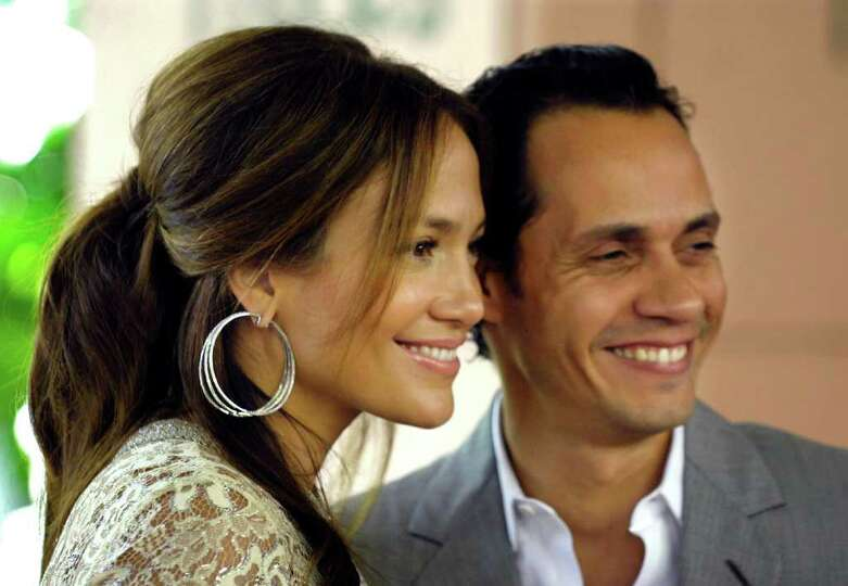 Jennifer Lopez, left, and husband Marc Anthony arrive for the Hollywood Foreign Press Association's