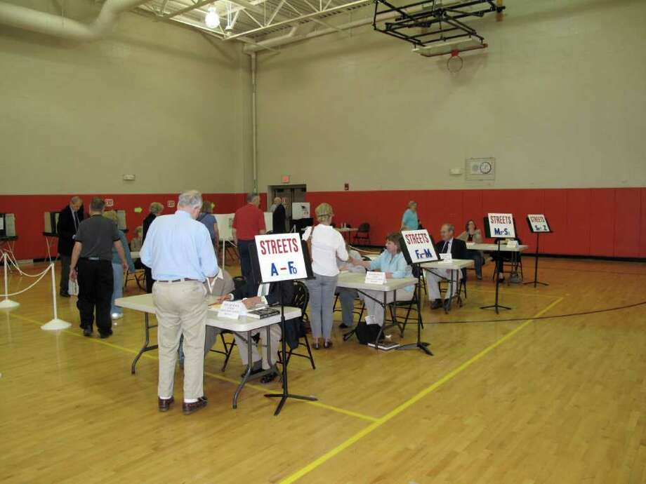 Residents wait their turn to vote at the New Canaan High School gym for the referendum on the $4 million bond for road paving and potentially sidewalks. Photo: Contributed Photo / New Canaan News