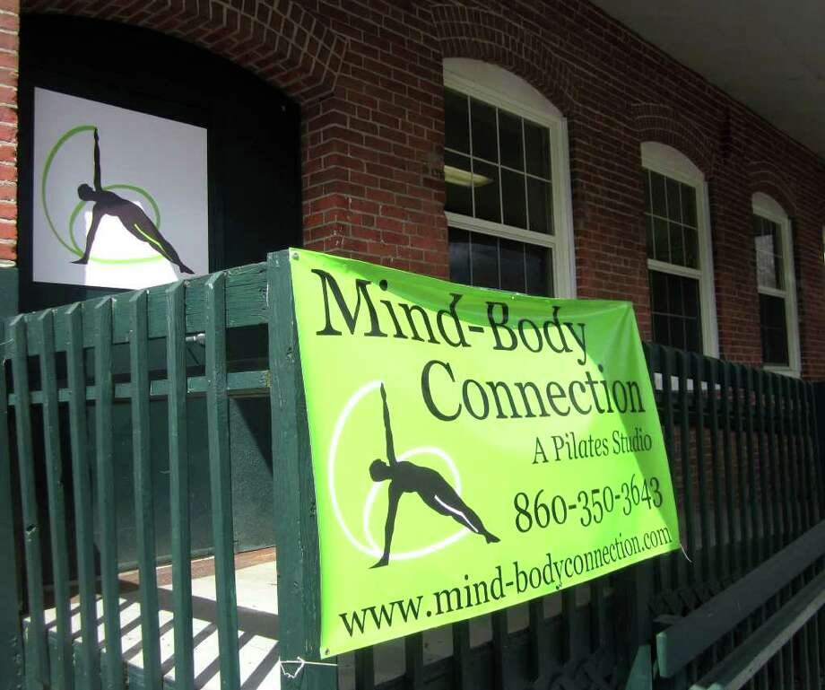 SPECTRUM/The Mind-Body Connection Pilates studio is located in the refurbished former Robertson's Bleachery building at the south end of West Street in New Milford. April 21, 2011 Photo: Norm Cummings / The News-Times