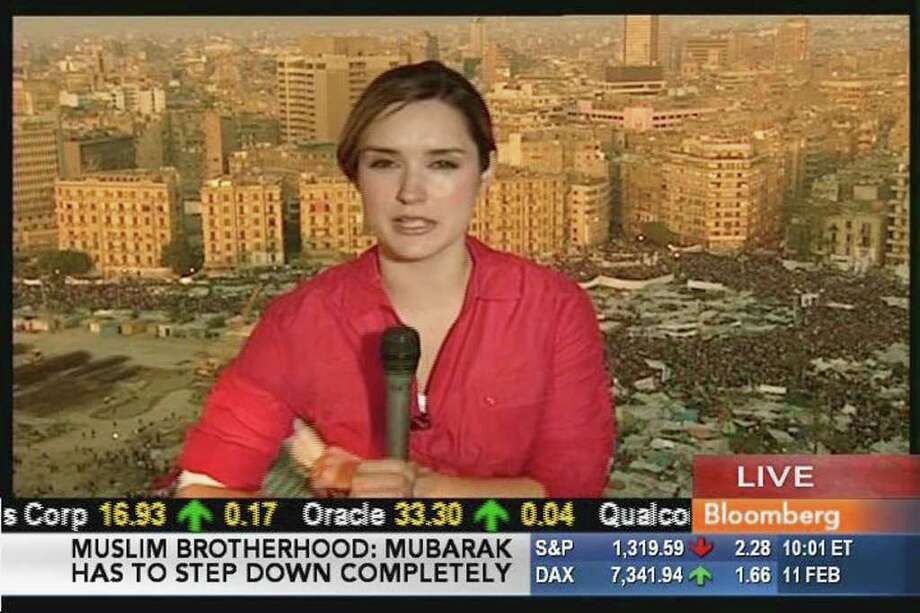 "Margaret Brennan, a Convent of the Sacred Heart grad, is the anchor of ""InBusiness with Margaret Brennan,"" on Bloomberg Television. Here, Brennan reports from Cairo as Egyptian President Hosni Mubarak prepared to step down from power. Photo: Contributed Photo / Greenwich Citizen"
