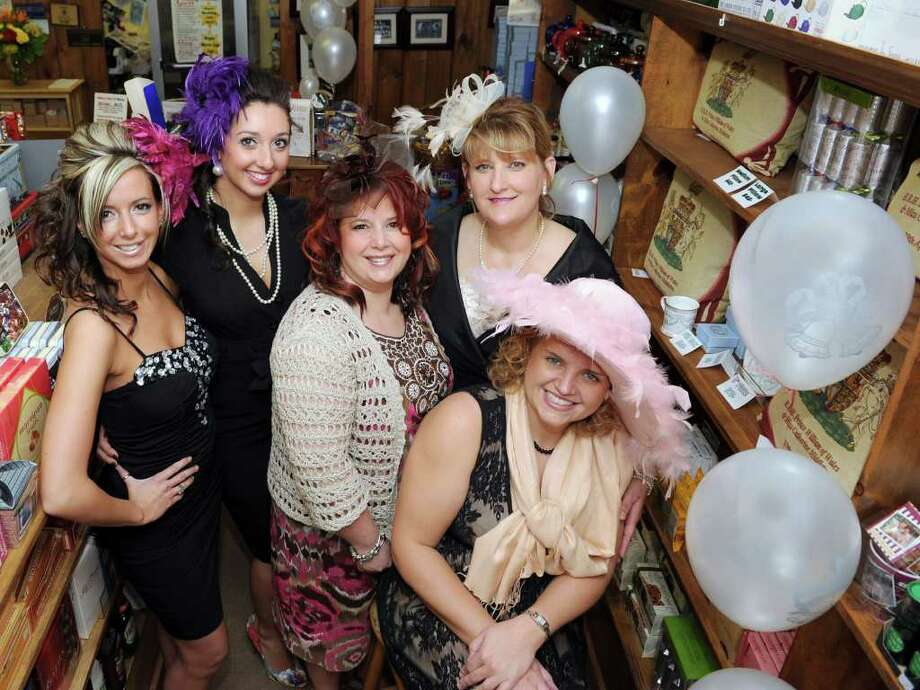 Wednesday is the rehearsal for the wedding of Prince William and Kate Middleton in Great Britain. In honor of the occassion, local women gathered at UK Gourmet store in Newtown dressed in their wedding finery, including the thoroughly British hair decorations known as fascinators. From left, Lara Sarvaiva of Bethel, Alexa-Rae Morin of Brookfield, Toni Ribeiro of Brookfield, Lisa Whitmore of Brookfield and Beth Dingee of Middlebury. Photo taken at UK Gourmet in Newtown, Wednesday, April 27, 2011. Photo: Carol Kaliff / The News-Times