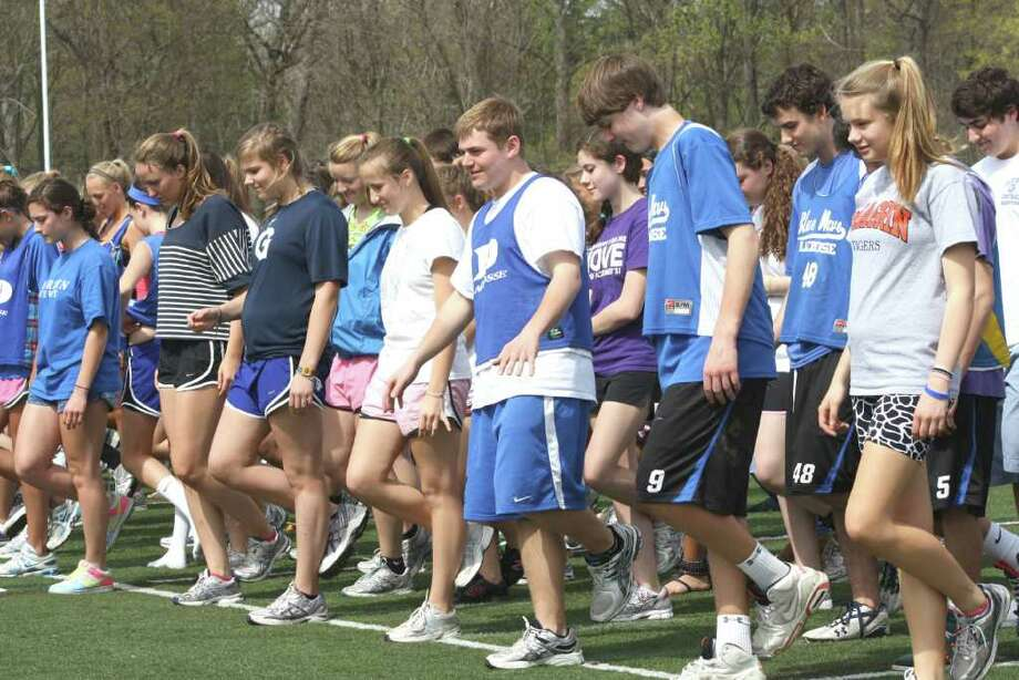 As part of a fundraiser for child abuse awareness, 360 DHS students broke the Guinness World Record for most people standing on one leg at the same time. Photo: Contributed Photo / Darien News