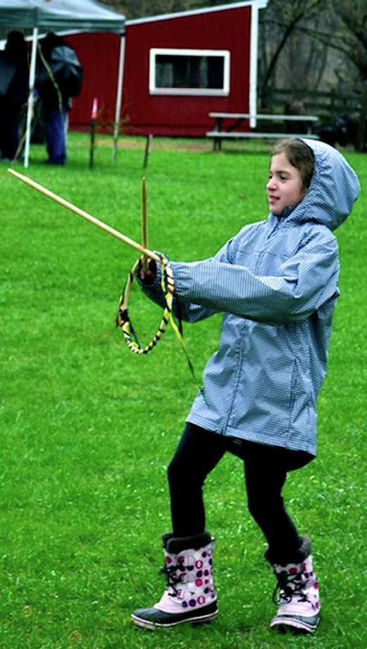 SPECTRUM/Katie Lukens, 8, of New Milford revels in a game of race hoops during her visit to the Earth Day celebration held April 23,. 2011 at the Pratt Nature Center in New Milford. Photo: Cristina Bernardi / The News-Times Freelance