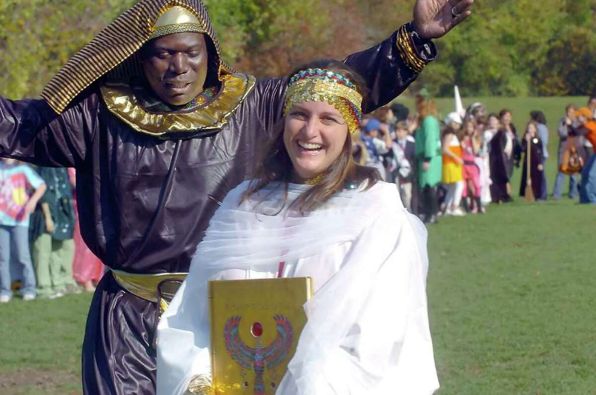 In this October 2007 file photo, Parkway School Assistant Principal Medard Thomas, left, and Principal Paula Bleakley in costume for the school's Halloween parade. Bleakley, the principal of Parkway School since 2005, is leaving the school at the end of June to take a position as principal of Holmes Elementary School in Darien, according to a statement from Greenwich Public Schools.