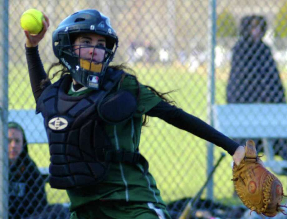 SPECTRUM/Standout catcher Jessica Murphy winds for a quick throw to first base for the Green Wave as New Miford High School softball takes on visiting Bethel, April 21, 2011. Photo: Norm Cummings / The News-Times