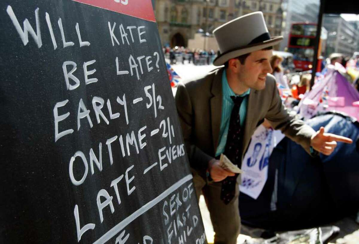 A bookmaker touts for trade on the pavement near to Westminster Abbey in London, Wednesday, April 27, 2011. Royal enthusiasts are camping out outside the Abbey where Prince William and Kate Middleton are due to get married on Friday, April 29. (AP Photo/Kirsty Wigglesworth)