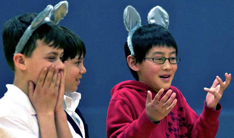 "SPECTRUM/Codie Holick, left, Matt Clarke, center, and Charlie Cao rehearse their roles Monday for the upcoming production of ""The Mice of Merwinsville"" at Sarah Noble Intermediate School in New Milford. ""The Mice"" will be presented to the public Friday, April 29 at 7 p.m. at the school.  Charlie Cao (grade 5), Matt Clarke (grade 5), and Codie Holick (grade 6), during play practice for ""The Mice of Merwinsville"" at SNIS.  The show will be held Friday, April 29th at 7:00pm at SNIS. Photo: Trish Haldin / Trish Haldin"