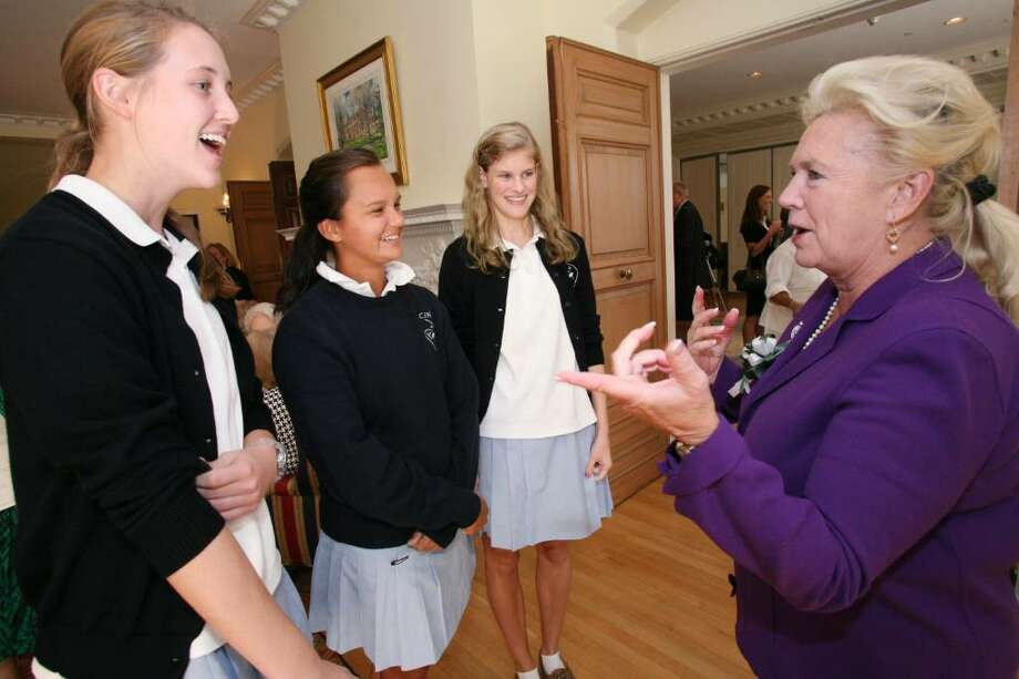 New Head of School at Convent of the Sacred Heart, Pamela Juan Hayes, speaks with juniors Kathleen Spillane, Emily Hatton, and Lacey Henry after Ms. Hayes Installation ceremony Friday morning. Photo: David Ames / Greenwich Time