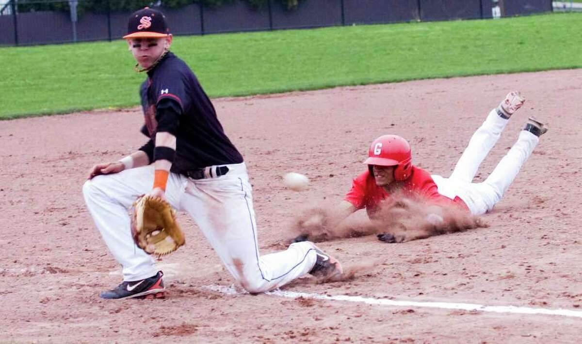 Greenwich's Joel Arroyo slides safely into third as Stamford's Phil D'Amico receives the ball as Stamford High School hosts Greenwich in a baseball game in Stamford, Conn., April 27, 2011. Stamford won 3-1.