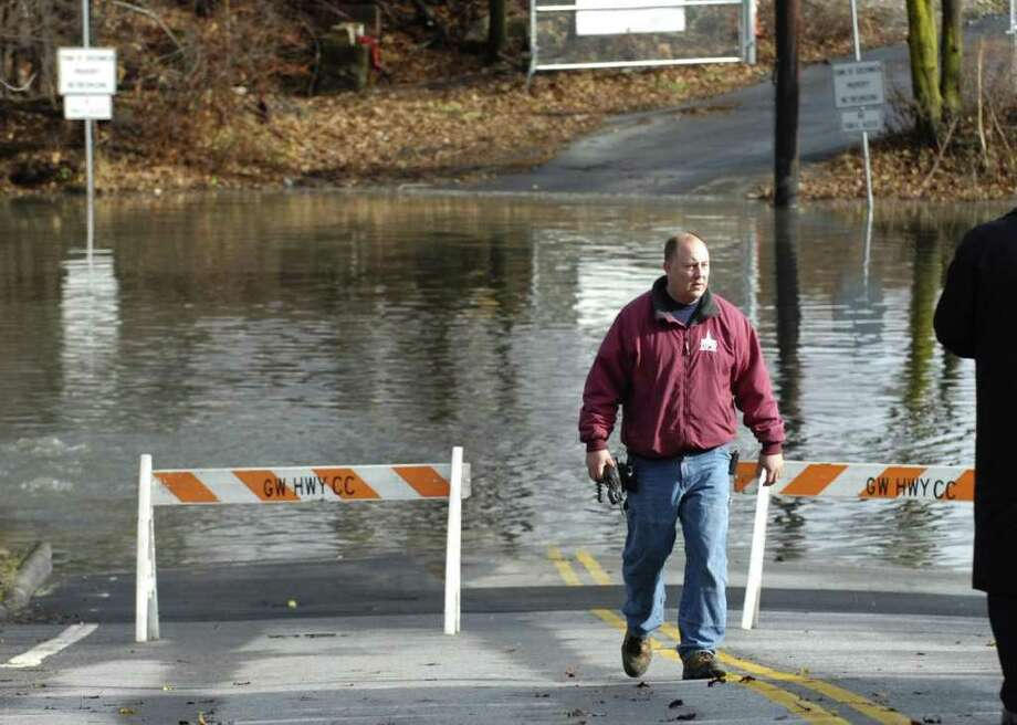 In this Dec. 12, 2008, file photo, Robert Grierson of Greenwich Public Works at the scene of a break in a sewer main on Sound Shore Drive in Cos Cob. About 28 million gallons of raw sewage spilled into the Mianus River over the course of a four-day period. Photo: File Photo / Greenwich Time File Photo