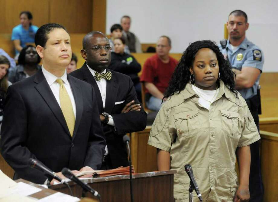 Tanya McDowell is arraigned in Norwalk Superior Court on larceny charges in Norwalk,  Conn. on Wednesday April 27, 2011. McDowell's attorney's Michael Thomas and Darnell Crosland stand with her. McDowell allegedly used a false Norwalk address to enroll her son in Brookside Elementary School. Photo: Kathleen O'Rourke / Stamford Advocate