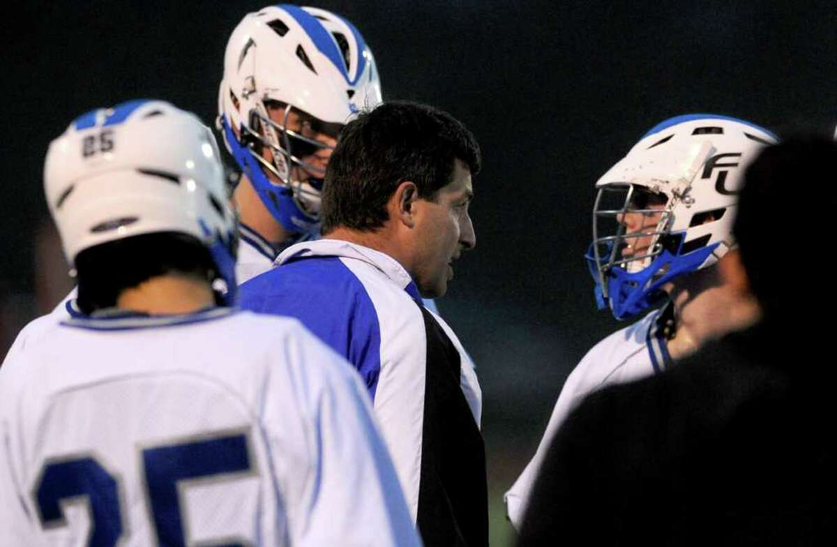 during Wednesday's lacrosse game against New Canaan at Fairfield Ludlowe High School on April 27, 2011.
