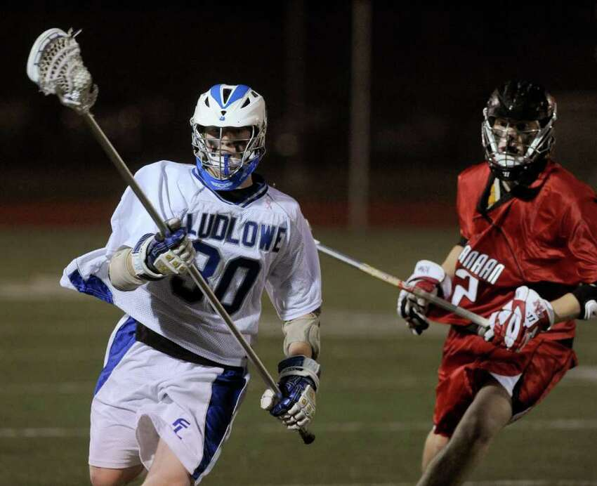 Ludlowe's Ryan Knowles carries the ball during Wednesday's lacrosse game against New Canaan at Fairfield Ludlowe High School on April 27, 2011.