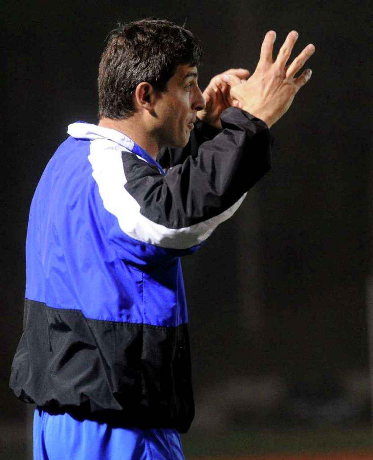 Ludlowe coach Chris Parisi talks to a referee during Wednesday's lacrosse game against New Canaan at Fairfield Ludlowe High School on April 27, 2011.