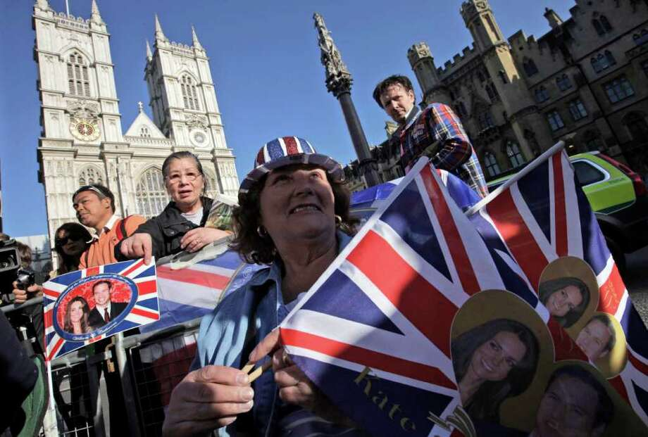 Royal enthusiasts camp across the road from the Westminster Abbey in order to ensure the best viewing spot,  for the upcoming royal wedding, in central London, Wednesday, April 27, 2011. Britain's Prince William and Kate Middleton will get married at the Abbey on Friday, April 29, 2011. (AP Photo/Lefteris Pitarakis) Photo: Lefteris Pitarakis / AP