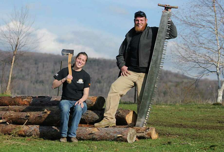 SUNY Cobleskill students Erin Urban of Altamont and Kyle Dente of Delmar pose for a photo before practice with the lumberjack team in Cobleskill N.Y. Wednesday April 20, 2011. (Lori Van Buren / Times Union) Photo: Lori Van Buren