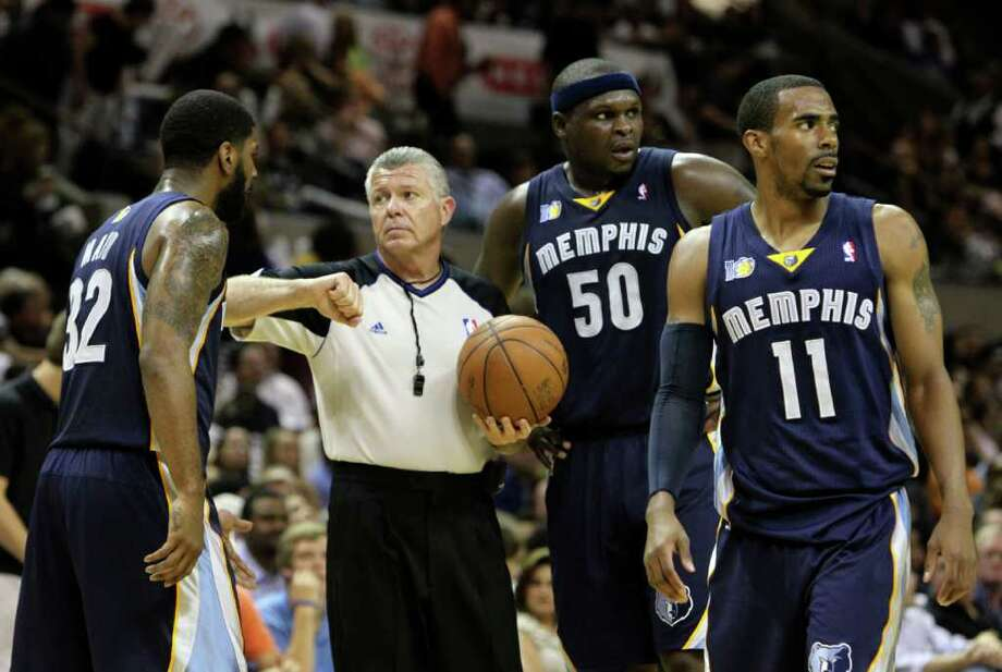 Memphis Grizzlies guard O.J. Mayo (32) talks with official Bob Delaney while  Memphis Grizzlies forward Zach Randolph (50) and  Memphis Grizzlies guard Mike Conley (11) look on in Game 5 of the first round of the Western Conference playoff at the AT&T Center on Wednesday, April 27, 2011. Kin Man Hui/kmhui@express-news.net Photo: KIN MAN HUI, SAN ANTONIO EXPRESS-NEWS / San Antonio Express-News NFS