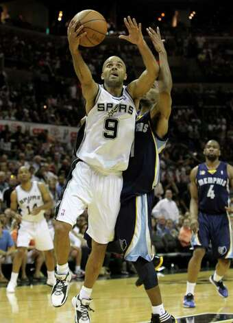 San Antonio Spurs guard Tony Parker (9) shoots in front of  Memphis Grizzlies guard Mike Conley (11) in Game 5 of the first round of the Western Conference playoff at the AT&T Center on Wednesday, April 27, 2011. Kin Man Hui/kmhui@express-news.net Photo: KIN MAN HUI, SAN ANTONIO EXPRESS-NEWS / San Antonio Express-News NFS