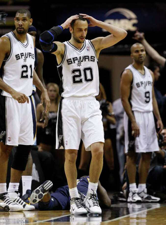 SPURS -- San Antonio Spurs guard Manu Ginobili (20) reacts after being called for a foul near San Antonio Spurs forward Tim Duncan (21) and San Antonio Spurs guard Tony Parker (9) during the second half of game five of the Western Conference First Round at AT&T Center, Wednesday, April 27, 2011. JERRY LARA/glara@express-news.net Photo: JERRY LARA, San Antonio Express-News / SAN ANTONIO EXPRESS-NEWS (NFS)