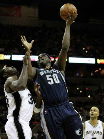 Memphis Grizzlies forward Zach Randolph (50) shoots over San Antonio Spurs forward Antonio McDyess (34) in Game 5 of the first round of the Western Conference playoff at the AT&T Center on Wednesday, April 27, 2011. Kin Man Hui/kmhui@express-news.net Photo: KIN MAN HUI, SAN ANTONIO EXPRESS-NEWS / San Antonio Express-News NFS