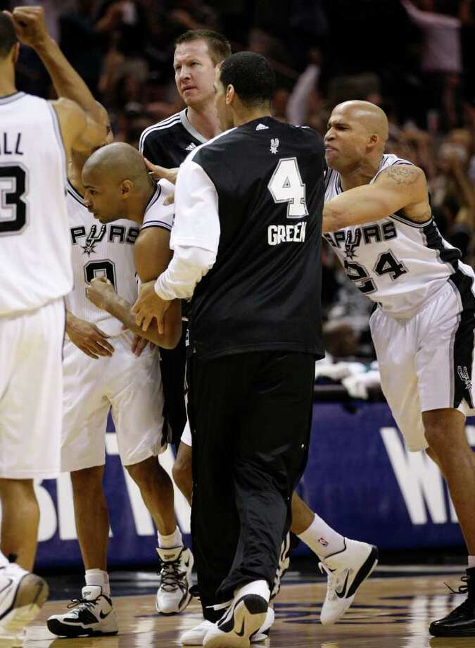 SPURS -- San Antonio Spurs guard Gary Neal (14) is mobbed by teammates, including San Antonio Spurs forward Antonio McDyess (34) after Neal hit the game tying shot during the second half of game five of the Western Conference First Round at AT&T Center, Wednesday, April 27, 2011. JERRY LARA/glara@express-news.net Photo: JERRY LARA, San Antonio Express-News / SAN ANTONIO EXPRESS-NEWS (NFS)