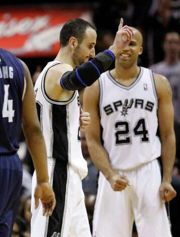 SPURS -- San Antonio Spurs guard Manu Ginobili (20) reacts near San Antonio Spurs forward Richard Jefferson (24) during overtime of game five of the Western Conference First Round at AT&T Center, Wednesday, April 27, 2011.  The Spurs won 110-103.  JERRY LARA/glara@express-news.net Photo: JERRY LARA, San Antonio Express-News / SAN ANTONIO EXPRESS-NEWS (NFS)